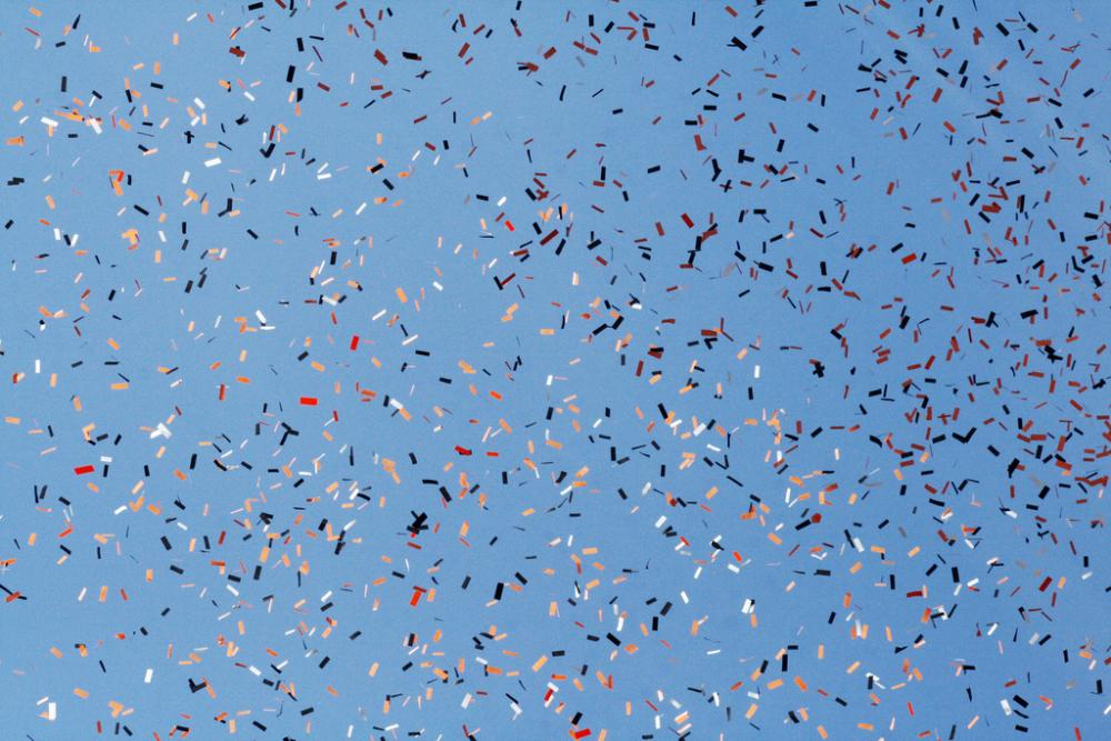 Sherrie Thai - Confetti Against a Blue Sky - CC BY 2.0
