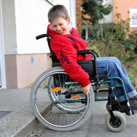boy-in-wheelchair-at-step