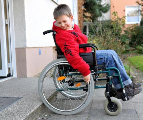 boy-in-wheelchair-at-step